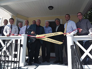 Mayor James J. Fiorentini celebrates a home rehabilitation project at 342 Primrose Street.