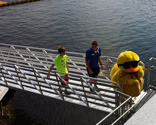 Haverhill Rotary's Quacky mascot, too tired to swim, takes the dock ramp instead.