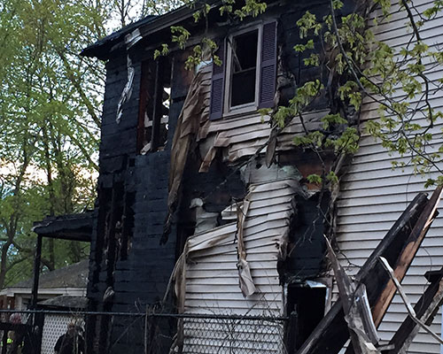 Fire officials believed the fire at 11 Woodrow Ave. began at the rear of the house.