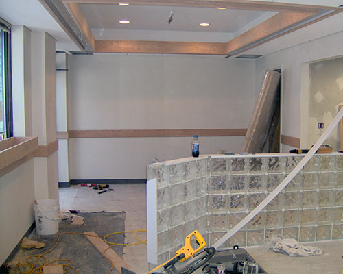 Glass block being assembled in the WHAV lobby during construction.