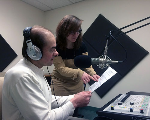 News Director Dana Esmel and Northern Essex Community College intern Sarah Tiso prepare a local newscast.