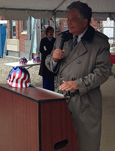 During a topping off ceremony at Harbor Place, Mayor James J. Fiorentini addresses the audience.
