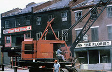 Demolition takes place in the Pentucket Urban Renewal District (Main and Water Street areas). (Photograph courtesy of David J. Connolly.)