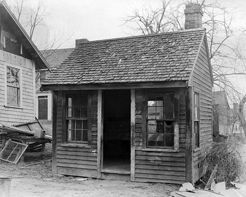 A larger photograph of the Rocks Village Toll House in the condition it was found by Henry Ford. (From the Collections of The Henry Ford.)