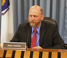 School Committeman Sven A. Amirian, who works for MassAmerican Energy, left the room for the vote.