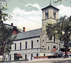 A vintage postcard displays the church with the the former Haverhill High School at rear.