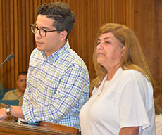 Haverhill City Councilor Andy Vargas stepped up to aid in translation. He is see with Ada Albino.