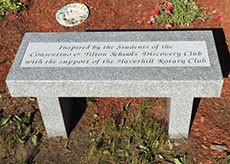 Another view of the granite bench, as installed in the garden by Haverhill Rotarian Richard Atwood of Atwood memorial Co.