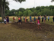 "Students from Tilton and Consentino Schools prepare the ""Butterfly Garden"" at Consentino School. (Courtesy photograph.)"