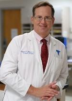 Dr. Gregory K. Johnson.