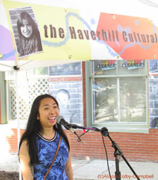 Phuong Pham, Haverhill High School graduate now enrolled at UMass Dartmouth, sings during the council's open mike tent during the Inside Out Event.