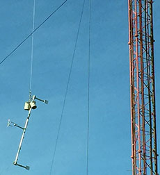 WHAV FM antenna being hoisted into place.