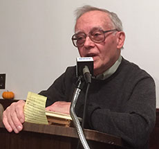 """Whittier Birthplace Curator Augustine """"Gus"""" Reusch reads a Whittier poem during the 132nd Annual Meeting of the Haverhill Whittier Club. (WHAV News photograph.)"""