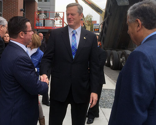 State Rep. Brian S. Dempsey welcomes Gov. Charlie Baker to downtown Haverhill as Mayor James J. Fiorentini looks on. (WHAV News photograph.)