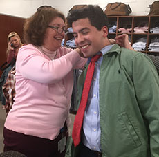 A Southwick store clerk helps Councilor Andy Vargas find his shirt size.