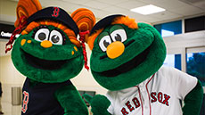 Red Sox mascots Wally and Tessie appear during the 52nd Annual VFW Santa Parade.
