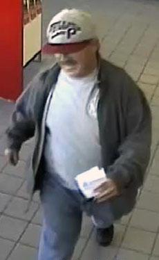 Surveillance photograph of a robbery suspect at Santander Bank.