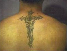 DeLarosa has a tattoo—a large cross on his back extending up to the base of his neck.