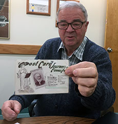 Richard K. Tracy shows one of the more than 325 Whittier Birthplace postcards in the collection he donated to the museum.