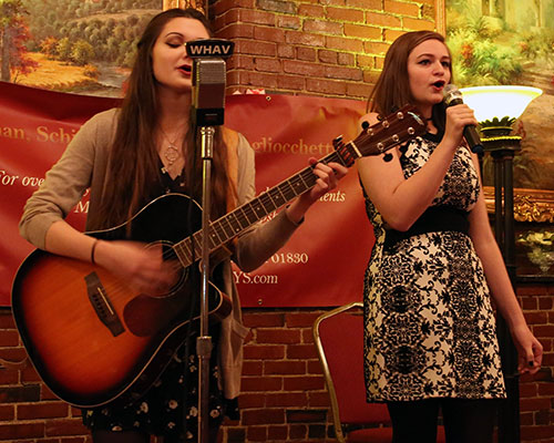 """Haverhill High School Chorus members Emily Forisso and Chloe Reynolds performed """"""""Black Horse and a Cherry Tree."""""""