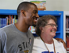 Malcolm Mitchell with Tilton library staff. (Courtesy photograph.)