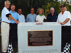 Ken Smith, left, and others at the dedication of the Pines Speedway monument in Groveland. (From the collection of Russ Conway.)
