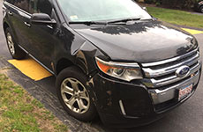 The Ford Edge sport utility vehicle received damage to the passenger side front and fender. (WHAV News photograph.)