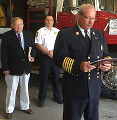 Fire Chief William F. Laliberty addresses a small audience at the Water Street Fire Station, while Ronald Meehan, of the Massachusetts Property Insurance Underwriting Association, and Haverhill Police Capt. Stephen Doherty look on. (WHAV News photograph.)